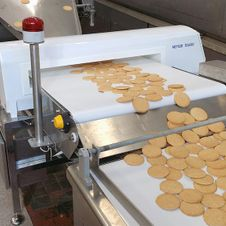 Metal detector conveyors for food products